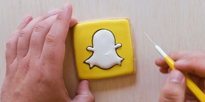 Picture of a person making a Snapchat cookie.